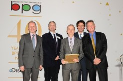 Ian Hislop (centre) and the production team of The Wispers Times receive their Best Single Drama Award from Michael Palin